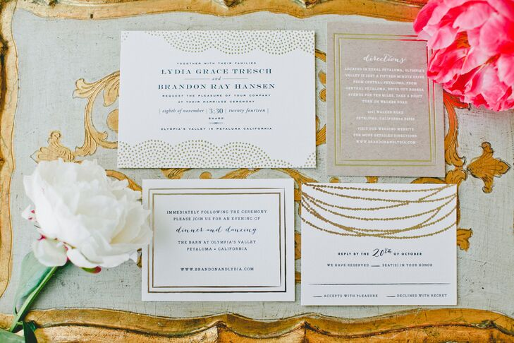 The invitations, white stationery with gold designs, gave guests a glimpse of the rustic-glam wedding to come. The directions sheet had white text printed on brown paper, which stood out from the rest of the collection.
