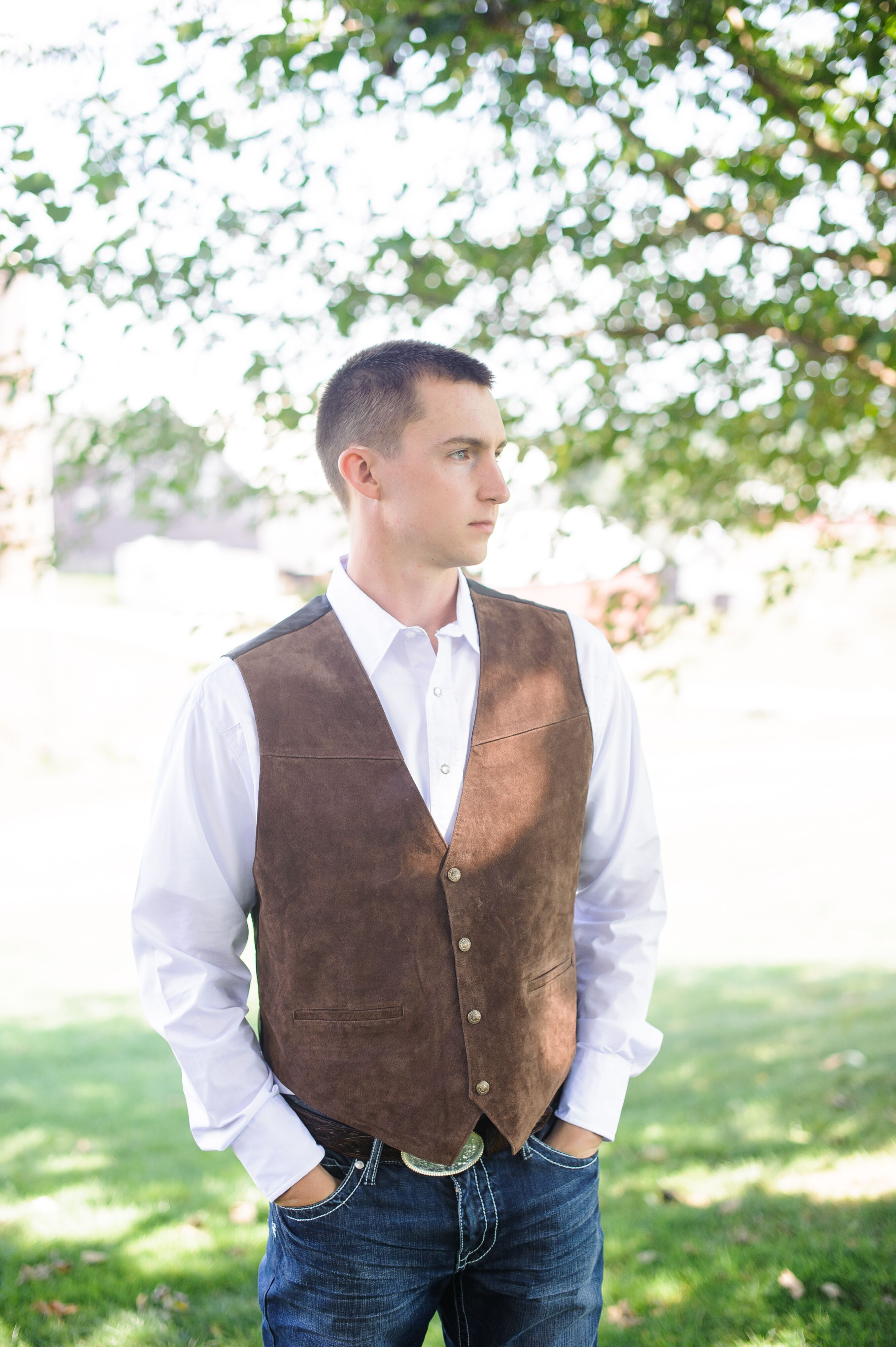 Groom In A Brown Vest And Jeans On Wedding Day
