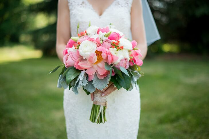 The bride carried a bouquet of pink peony, white and pink roses and eucalyptus leaves. The stem was wrapped in silk and lace.