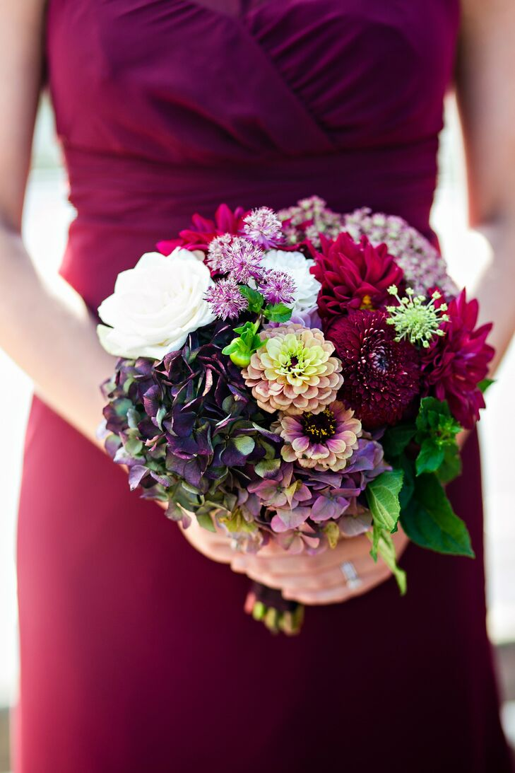 Annslee's bridesmaid bouquets had her favorite flowers: antique hydrangeas (those purple and green ones that you see are one example of how pretty they can be). Jars of Flowers also included roses, dahlias and astrantias to the fall-inspired mix.