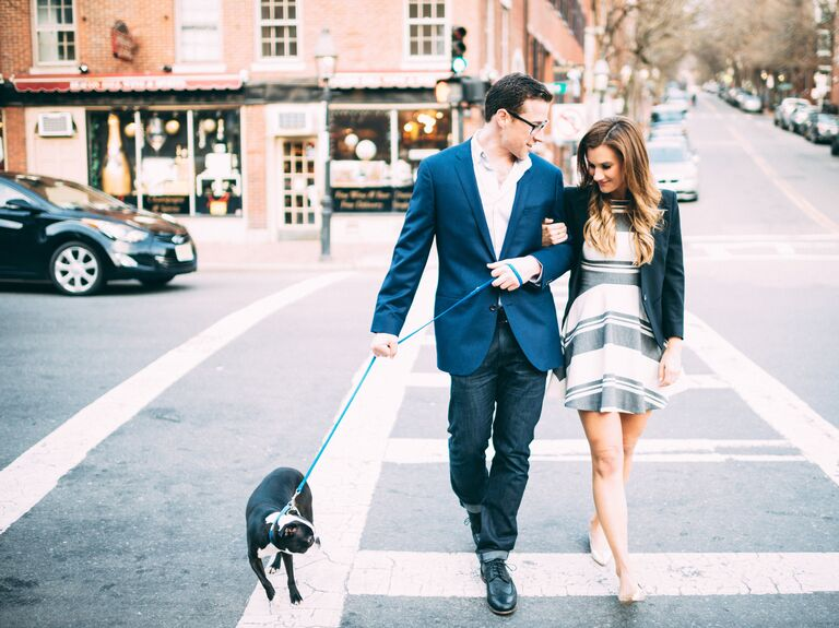 Engaged couple with dog