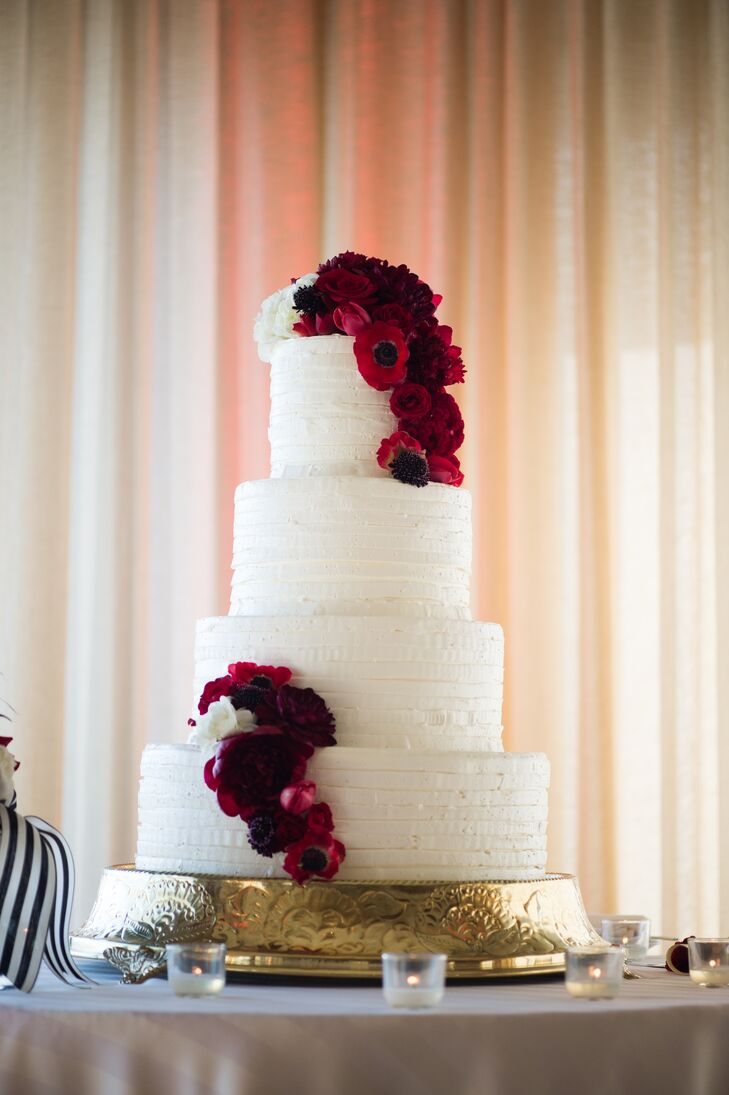 White Buttercream Wedding Cake With Red Flowers