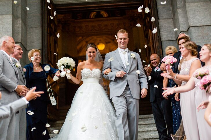 Victoria and Matthew left the Church of St. Francis Xavier under a shower of ivory rose petals, tossed by guests and the wedding party.