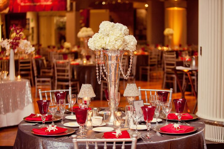 Chrome vases held a bundle of white hydrangeas dripping with crystals.