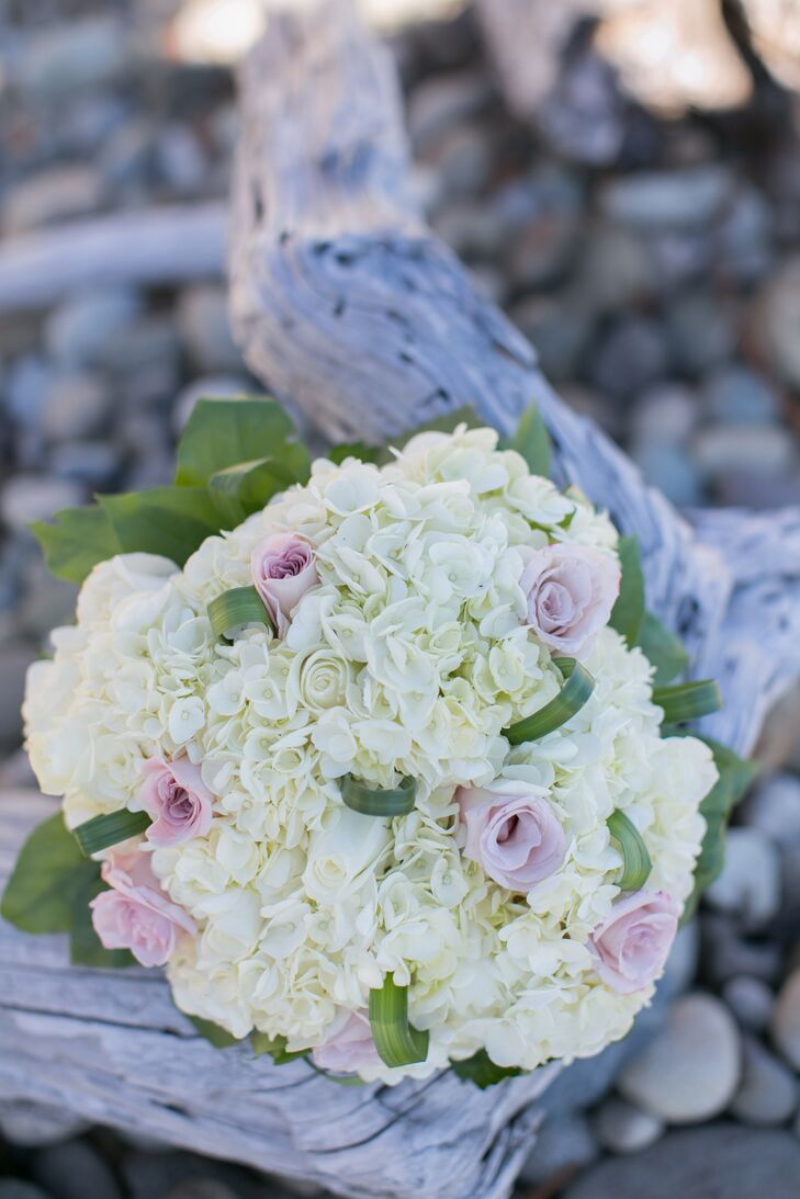 Lindsey walked down the aisle with an ivory hydrangea and pink rose bridal bouquet, which matched Matt's boutonniere made up of a single pink rose and ivory hydrangea.