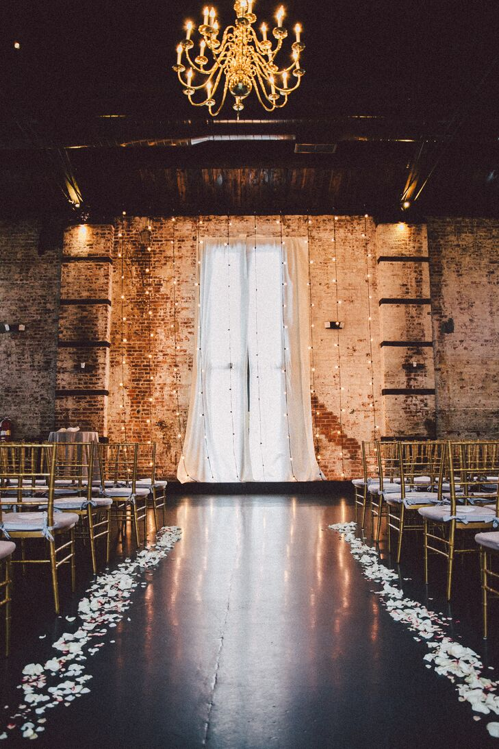 "After visiting The Green Building in Brooklyn, New York, Heather and Brian were sold. ""We fell in love with its effortlessly beautiful interior and the vintage flair,"" Heather says. The former brass foundry's exposed brick walls and wooden beams, brass chandeliers and speakeasy room equipped with vintage decor perfectly matched their wedding's Prohibition-era theme."