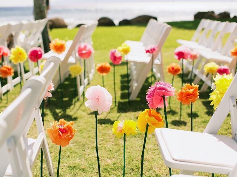 Bright colored paper flower ceremony aisle decor