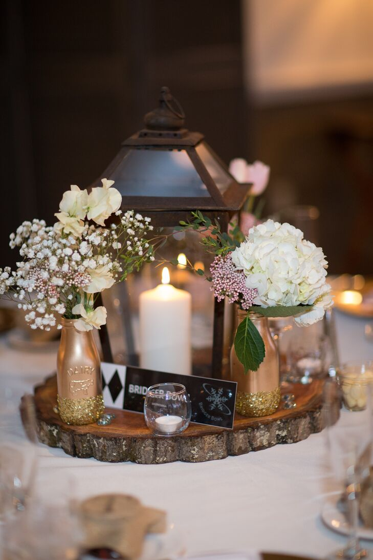 Rustic Lantern And Tree Trunk Centerpieces