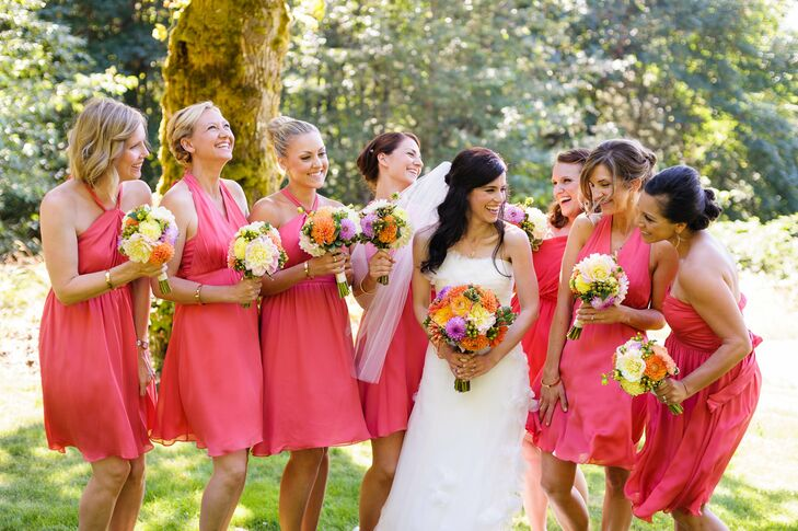 Megan's bridesmaids wore short bright pink dresses in a variety of styles.