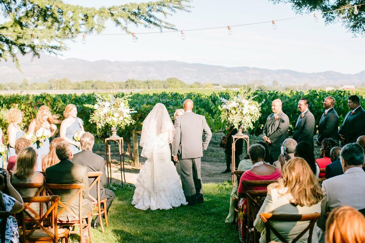 The Wedding Ceremony Took Place Outdoors Beneath String Lighting With Clic Napa Valley Scenery In
