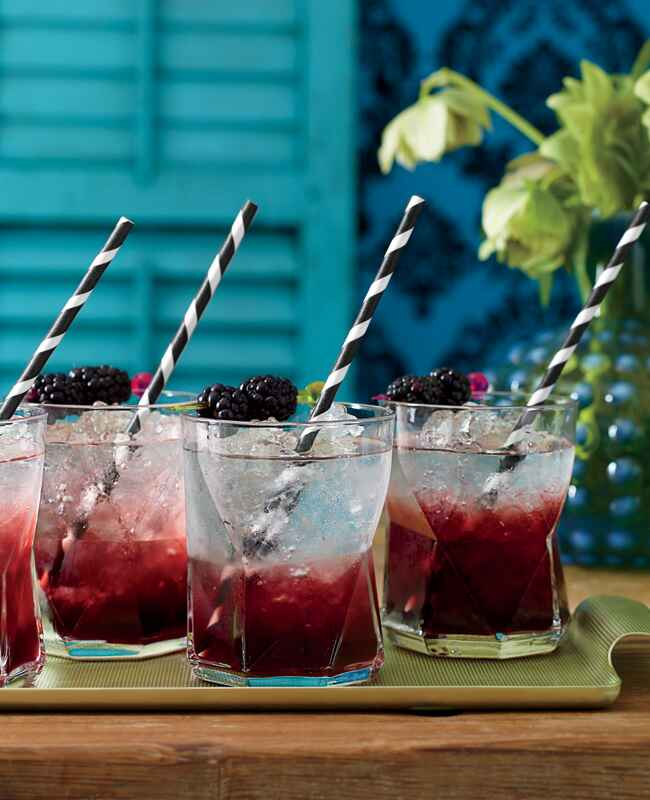 Blackberry signature cocktail with paper straws | Philip Ficks | blog.theknot.com