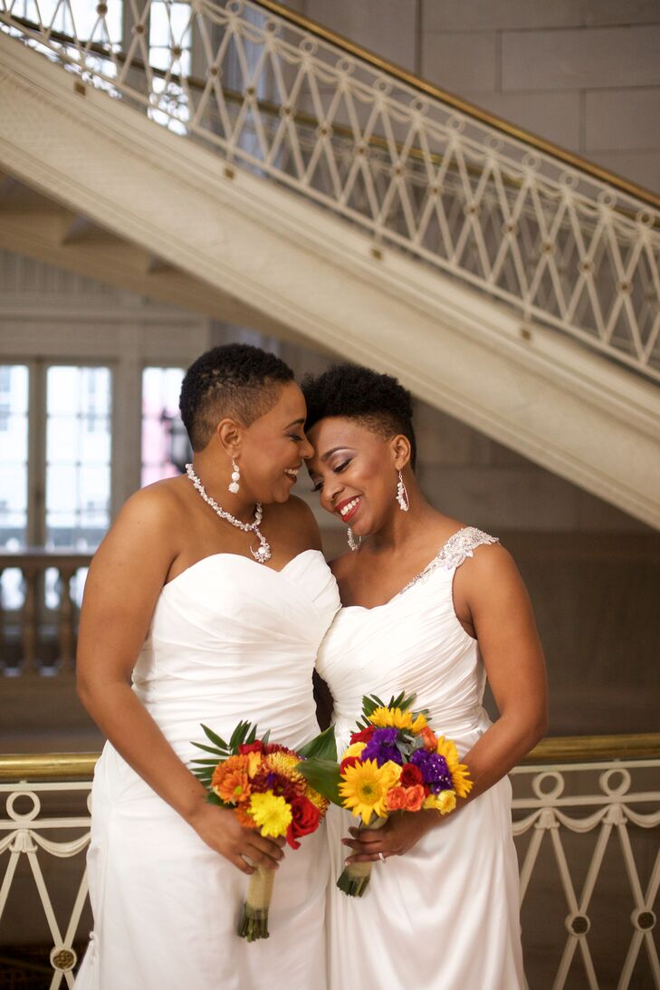 Charmagne wore a ruched, strapless wedding dress with a sweetheart neckline. Tianna wore a one-shoulder gown with beading on the strap. They bought their dresses from David's Bridal.