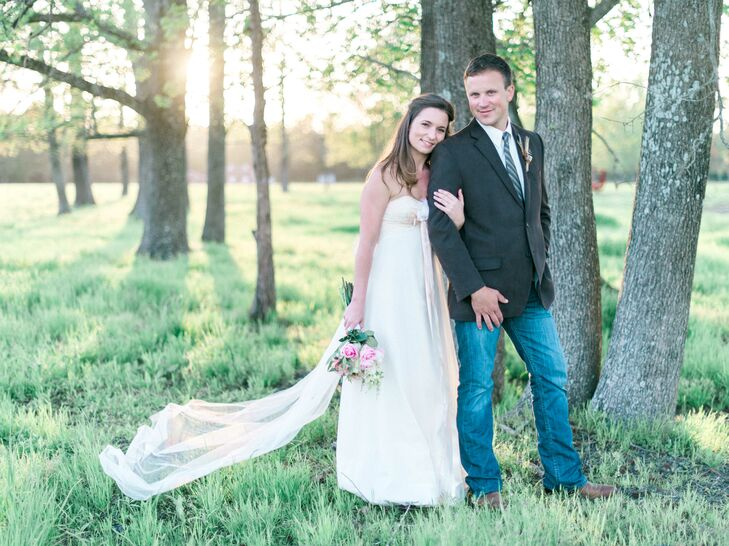 Ashley wore a romantic strapless ivory dress with a peach ribbon around the waist and lace detailing on the bodice. Her ring is a vintage estate ring from the 1940s, which fit the venue, Old River Farms in Burgaw, North Carolina.