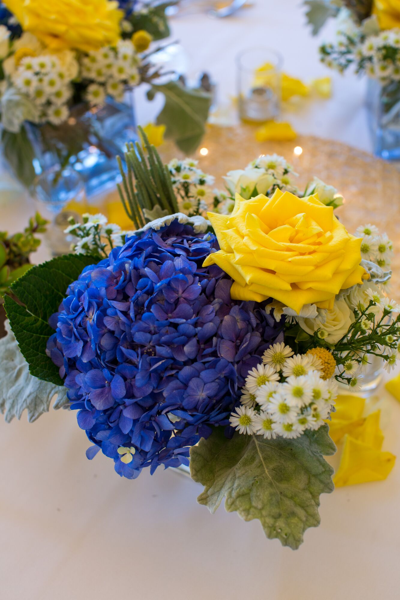 Yellow Rose And Blue Hydrangea Centerpiece With White Aster