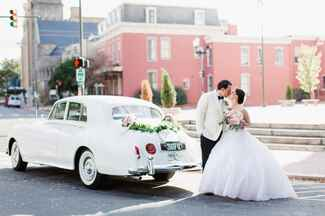 Married couple with vintage car