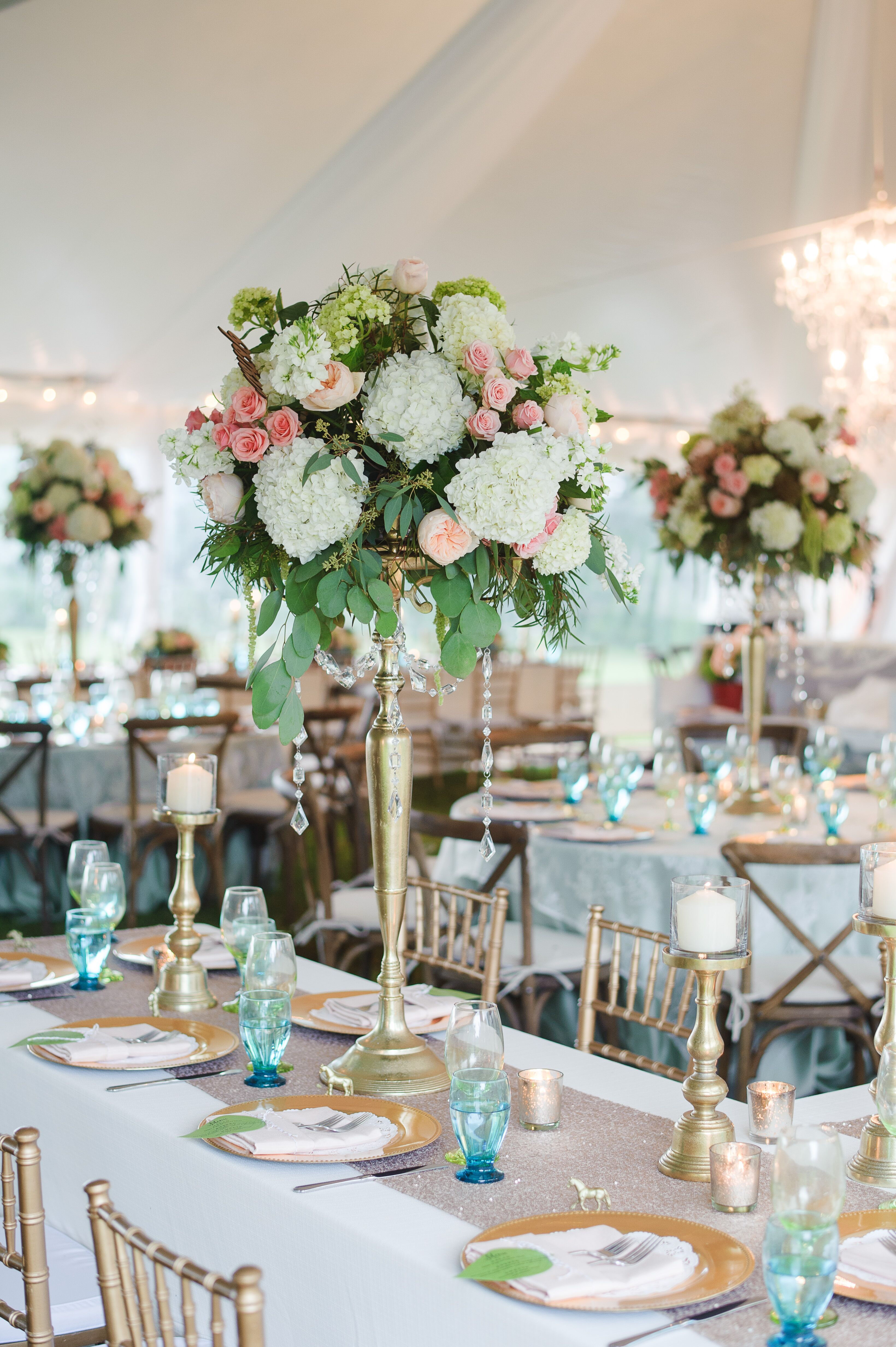 Tall white and blush centerpieces with gold accents