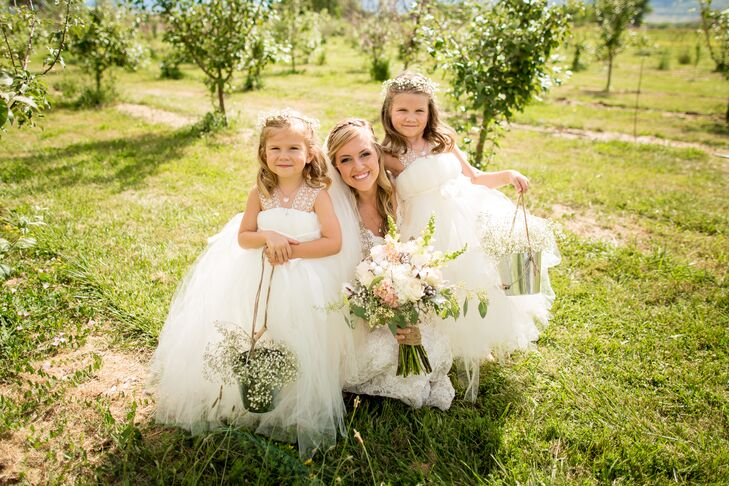 "The two flower girls wore these ivory tutu dresses. Leslie's friend made the dresses for the occasion. ""The girls looked like little clouds and were so happy in their poofy princess dresses and ballet slippers,"" Leslie says. They completed their look with baby's breath flower crowns."