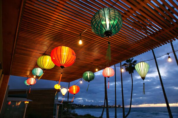 Hanging Paper Lanterns From Wood Ceiling