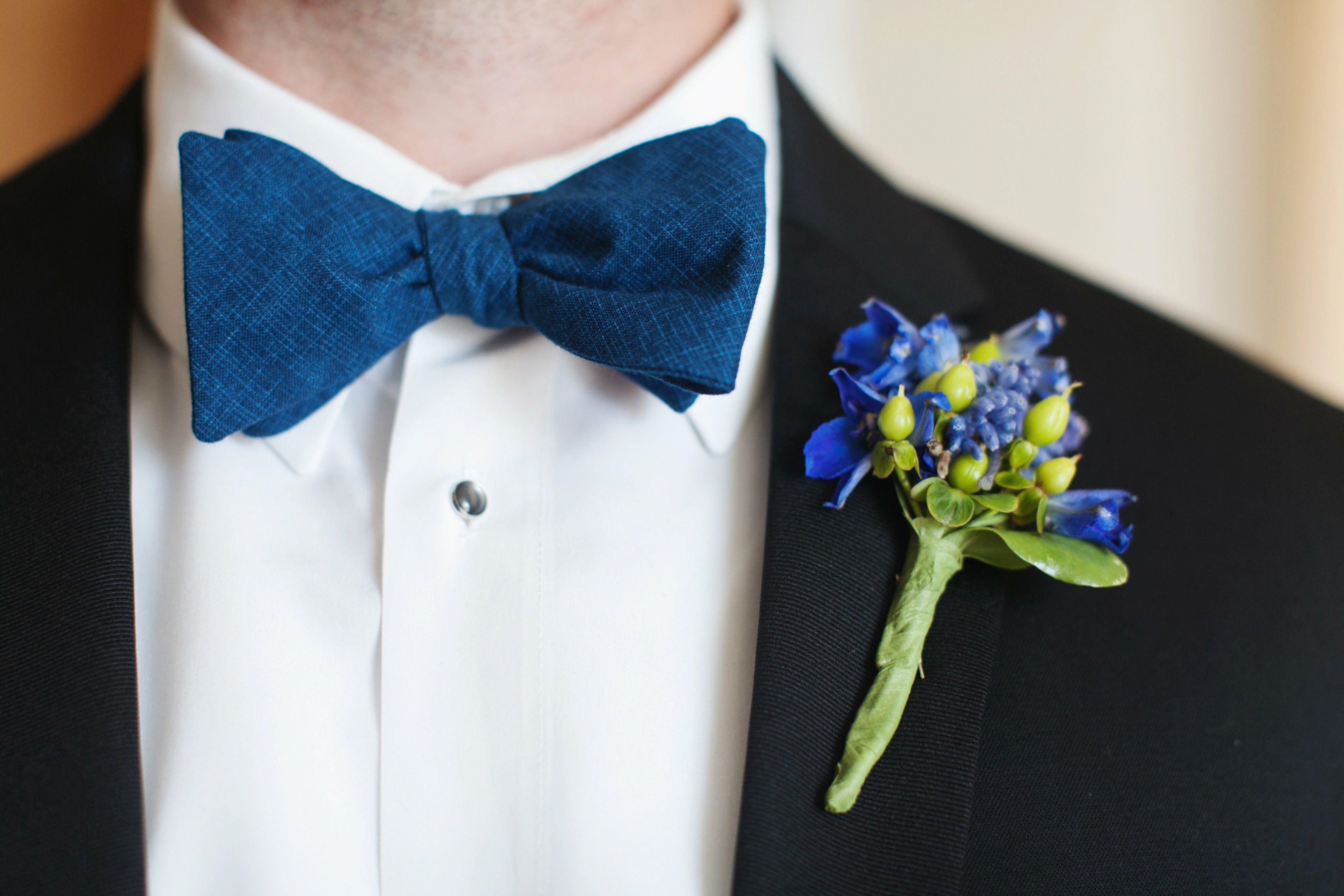 Blue Delphinium And Hypernicum Berry Boutonniere