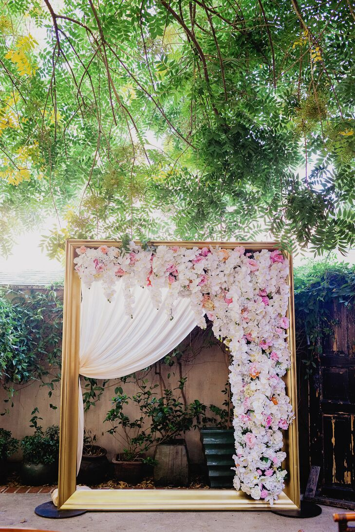 Golden Wedding Arch Draped With Florals
