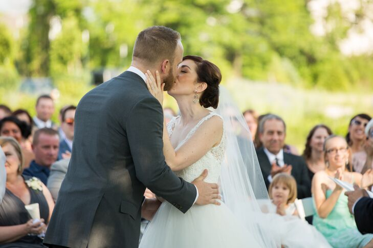 Elena wore a gorgeous pair of dangling earrings accented with crystals throughout the day—beginning with the ceremony, where Elena and Greg shared their first kiss.
