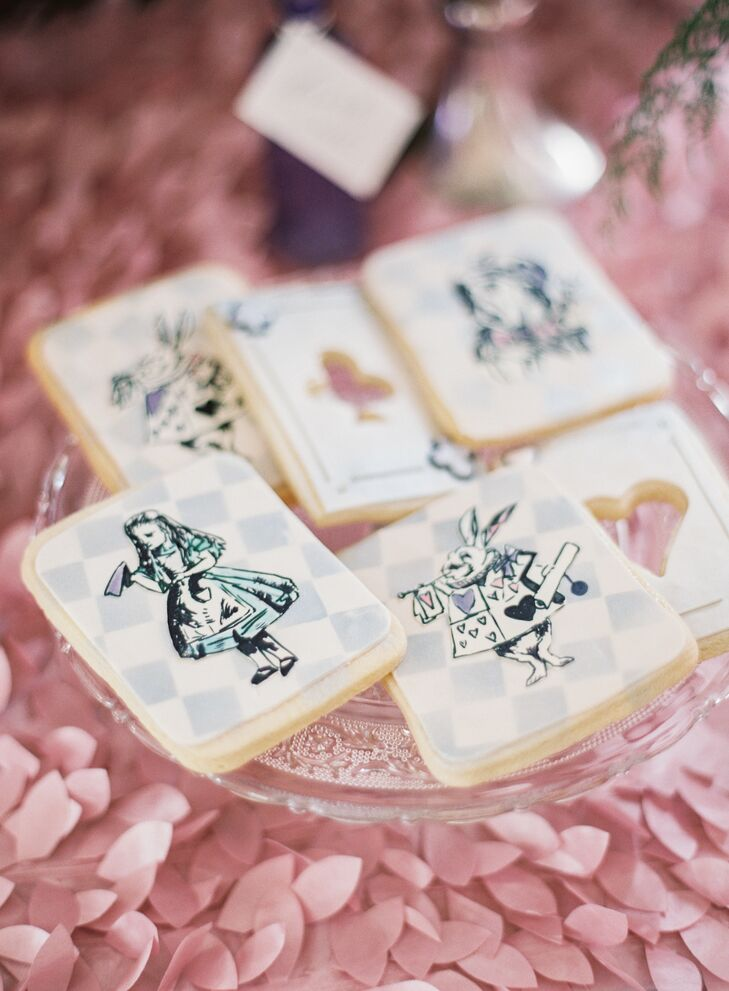 Guests received adorable Alice in Wonderland-inspired cookies as favors.
