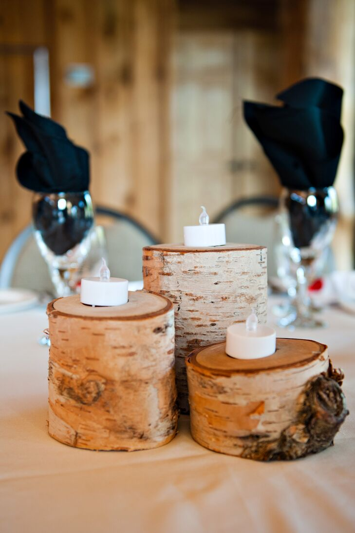 Electric candles were placed on circular wood bases for a rustic, romantic touch to the centerpiece decor.