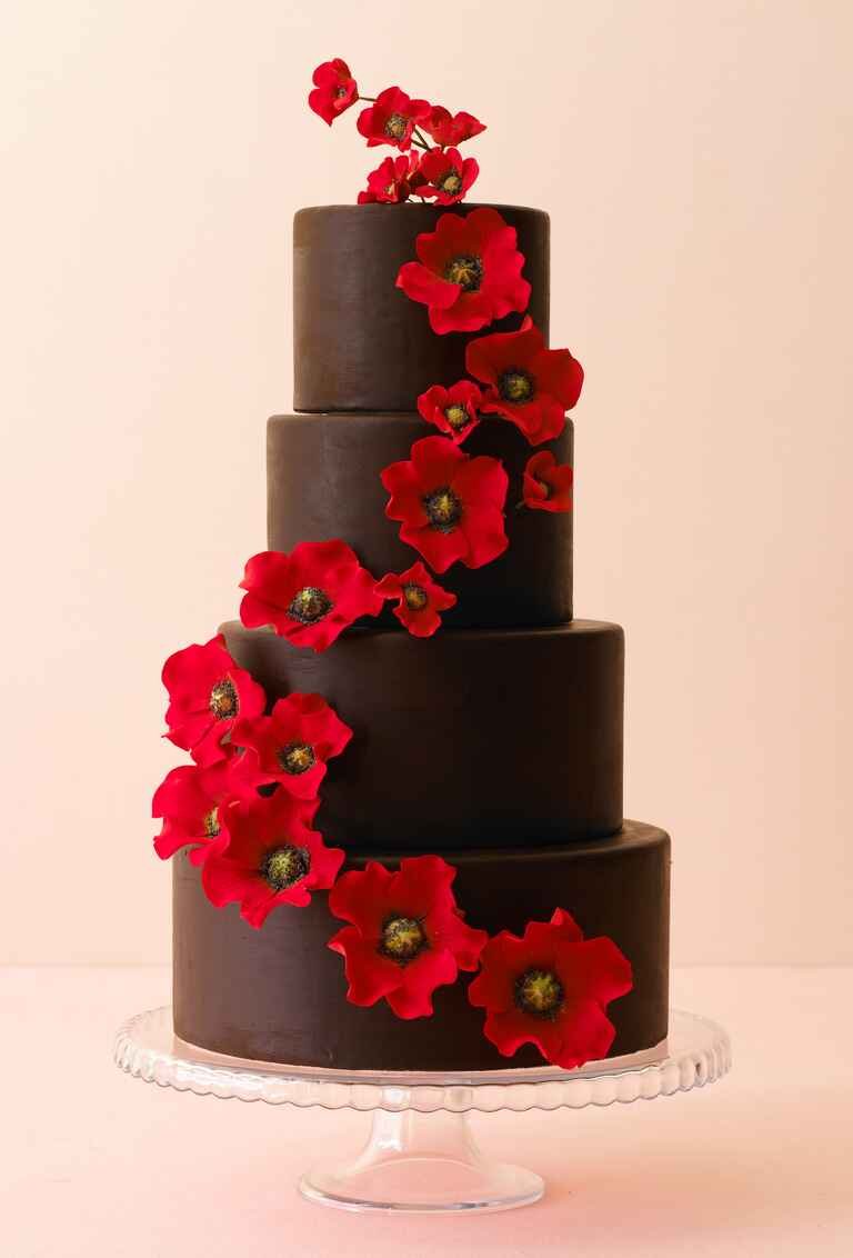 Chocolate wedding cake with red sugar flowers
