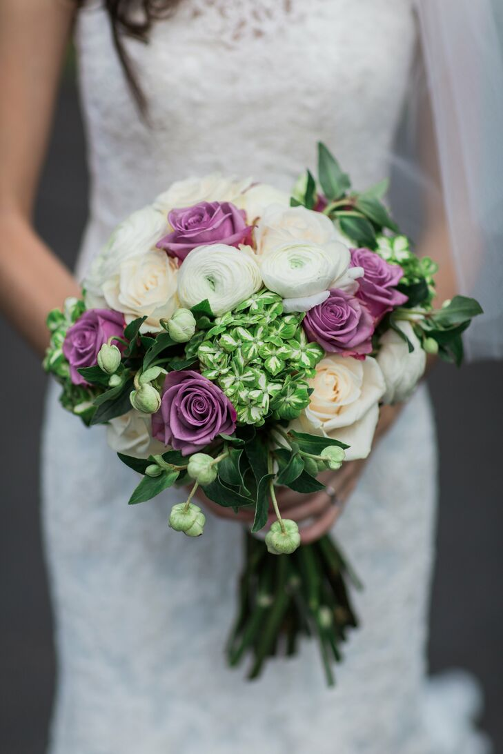 Arrangements of baby's breath dotted tables, while Tara carried a green and lavender bouquet comprising a fresh mix of ranunculus and roses.