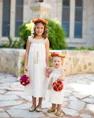 Cute flower girl idea with white dresses and colorful flower pomanders