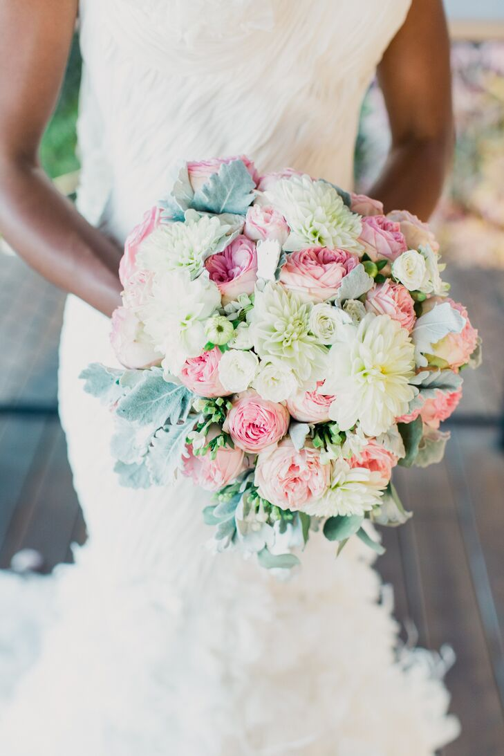 "Of course, Kristin and Andrew's theme called for an incredible bouquet. So she worked with the Flower Bazaar to design an arrangement that was brimming with pink roses, white tea roses, green ranunculus, lamb's ear, green hypericum and white dahlias. ""It doesn't get any better than that,"" Kristin says."