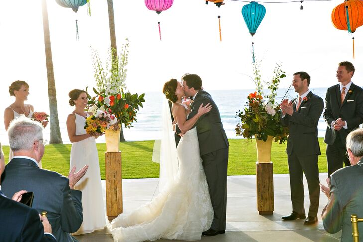 """An ocean backdrop was a must for the ceremony, and it doesn't get any better then the Forum in San Diego,"" says Suzanne. ""I fell in love with the modern yet warm and open space. It also lends itself perfectly for a natural progression from ceremony to cocktail hour to dinner and dancing."""