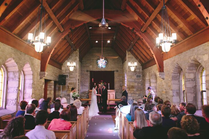 "Kaleigh and Jeff opted for a small, intimate ceremony at the Pilgrim Chapel in Kansas City, Mo. The couple were instantly drawn to the chapel's exposed stone walls, wooden beams and stained glass windows. ""We chose not to decorate the space at all,"" says Kaleigh. ""The chapel was so beautiful on its own and we did not want to take away from its beauty with added decor.""rn"