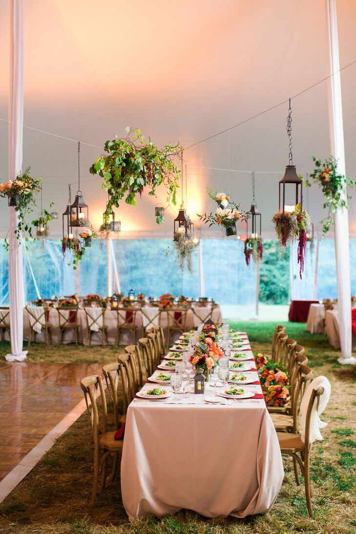 Lanterns overflowing with flowers and bushels of leafy greens hung above the dance floor and dining tables, bringing the natural vibe that surrounded them outside into the tented reception.