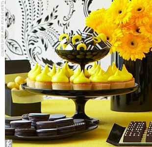 yellow and black wedding desserts