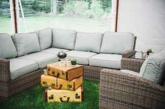 Lounge seating area with vintage suitcase coffee table