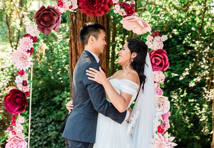 Classic Lace-Trimmed Wedding Veil and Paper Flower Arch