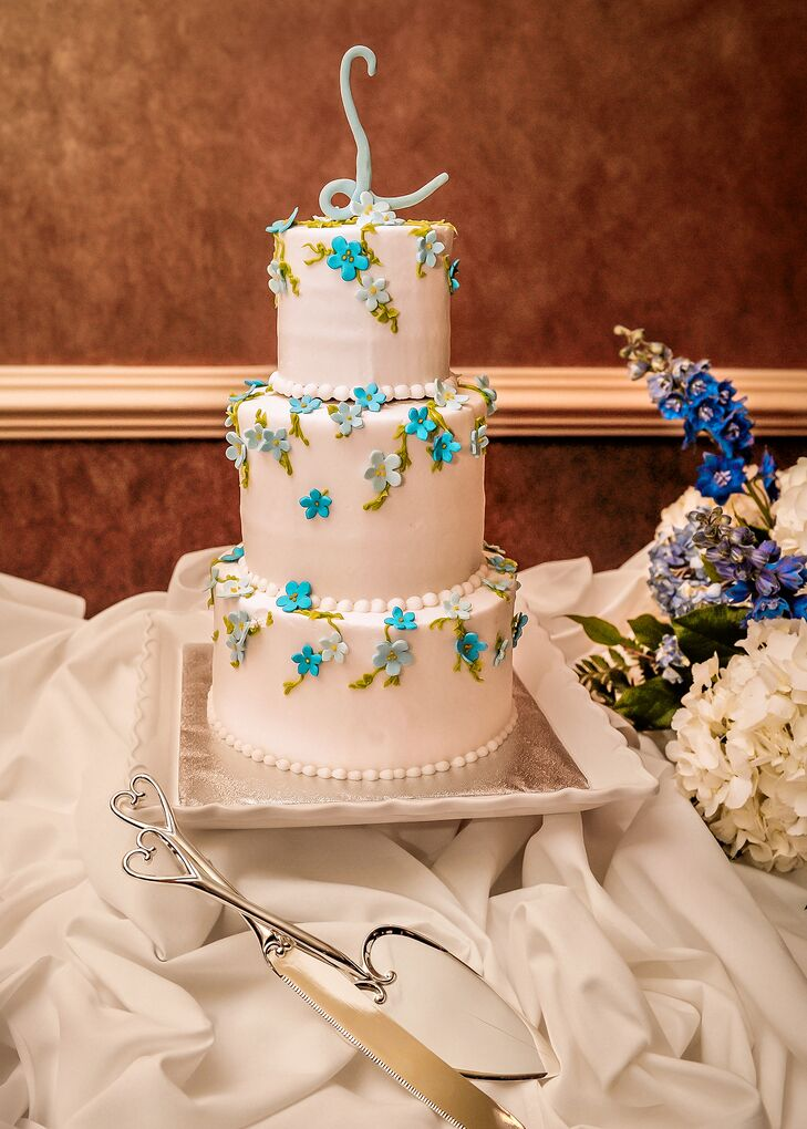 Classic White Wedding Cake With Blue Flowers