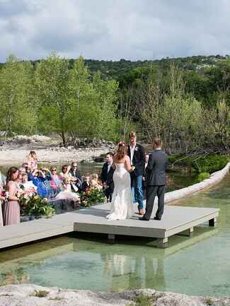 Unique wedding ceremony on a suspended platform over water