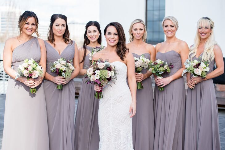 From the early stages of wedding planning, Karlee wanted her bridesmaids to wear floor-length gowns but was open to the exact style (whatever they felt comfortable in). The men wore classic black tuxedos with crisp white shirts.