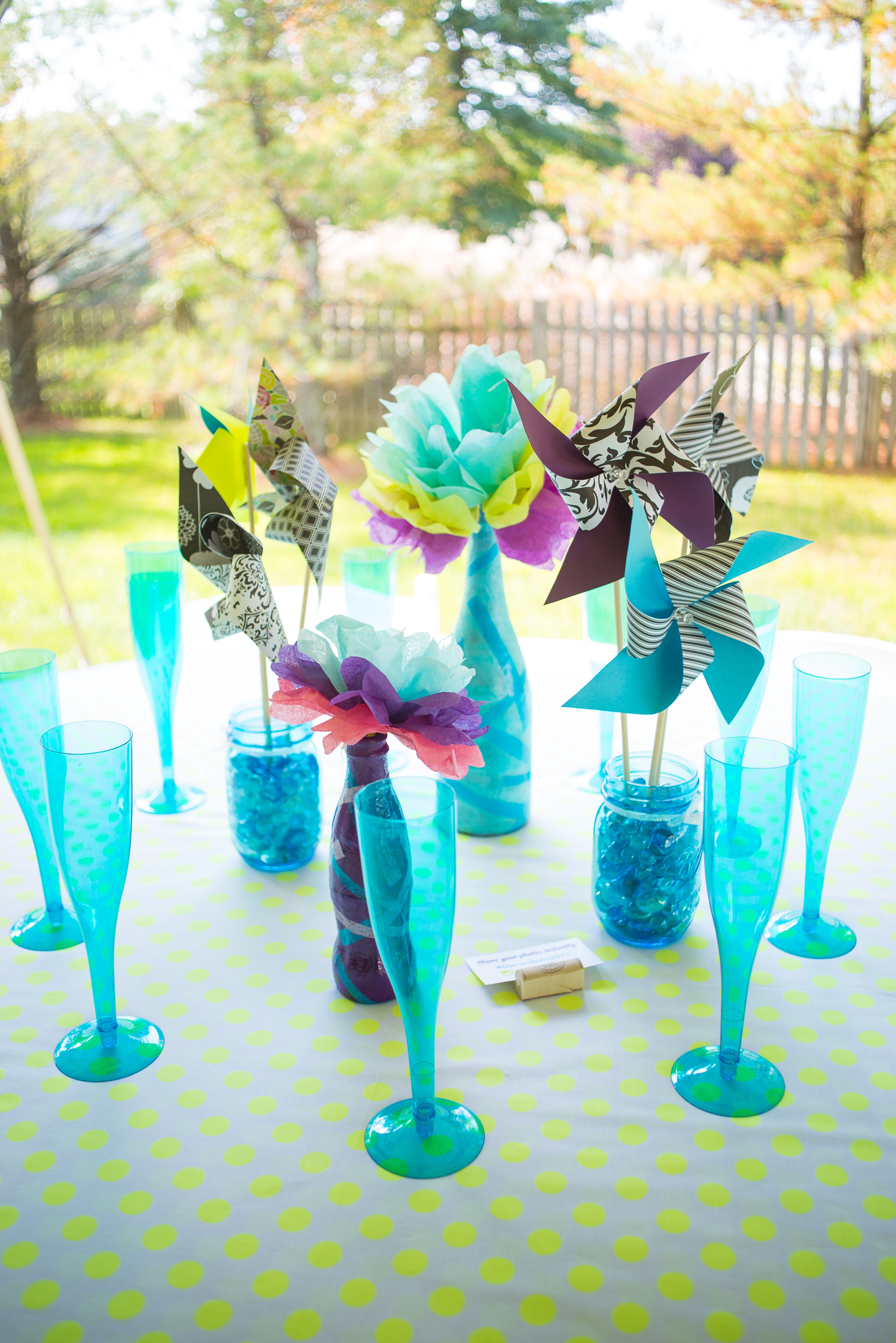 diy pinwheel centerpieces and bright blue glassware