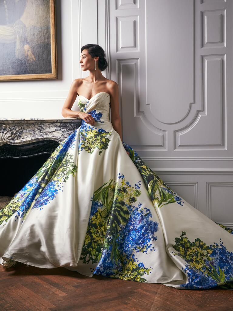 White ballroom wedding gown with hand-painted floral designs