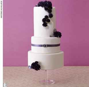 Purple and white belted wedding cake