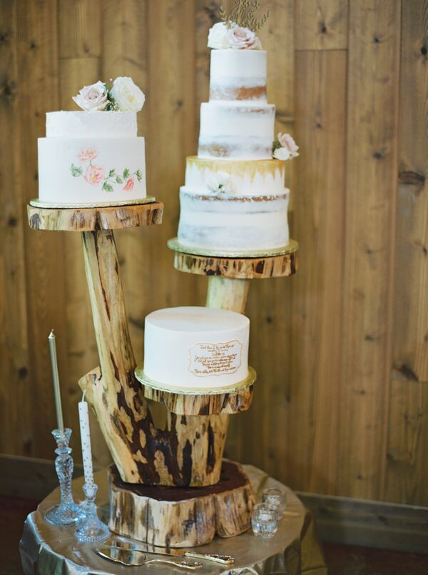 Rustic wedding cakes three wedding cakes displayed on stand made from a tree junglespirit Gallery