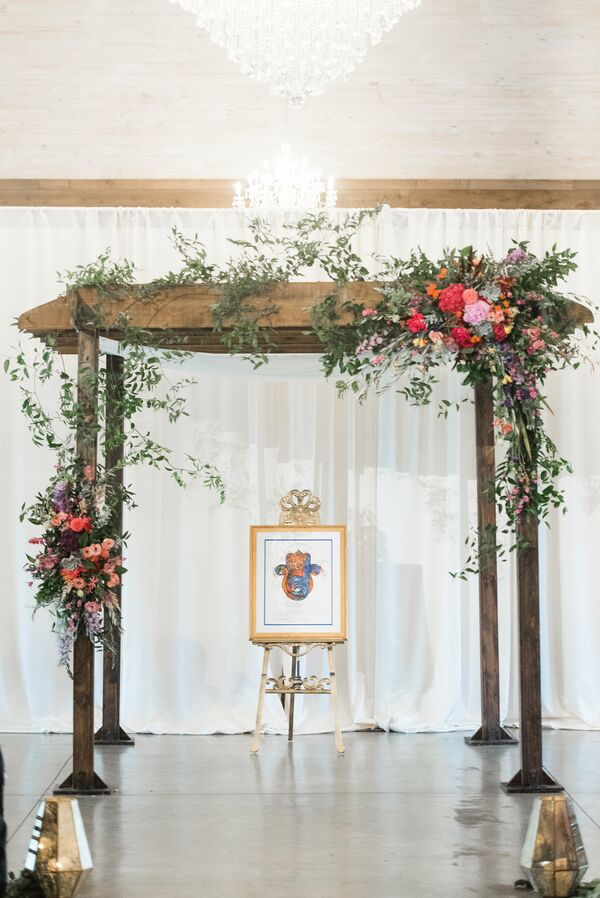 Rustic wedding arches natural wood chuppah with bright floral arrangements junglespirit Image collections