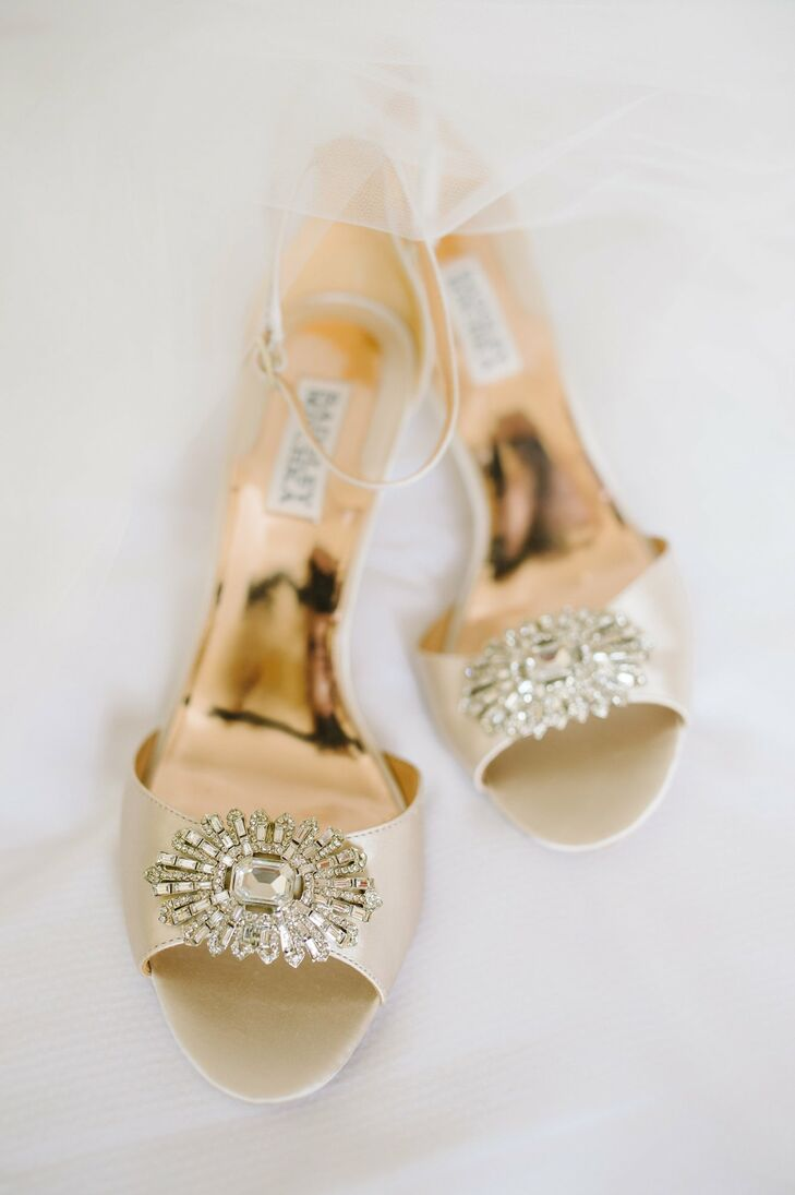 A pair of champagne Badgley Mischka ankle-strap heels completed Tara's bridal look.