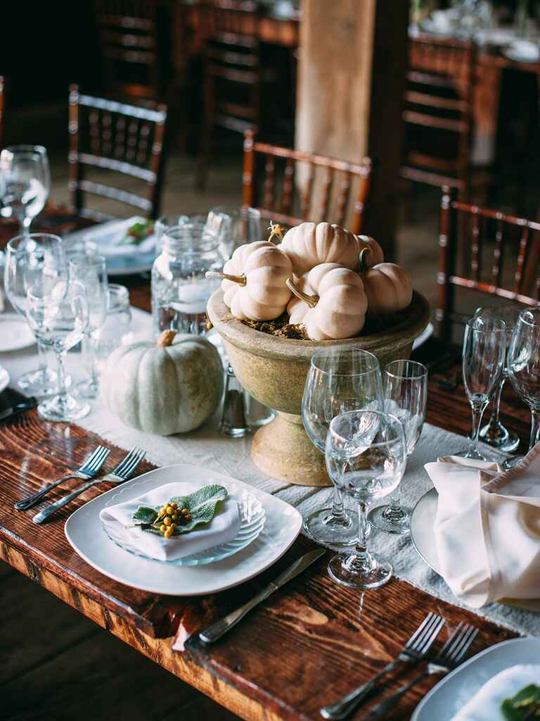 Pumpkin centerpieces for a sophisticated 'Cinderella' spin on wedding decor