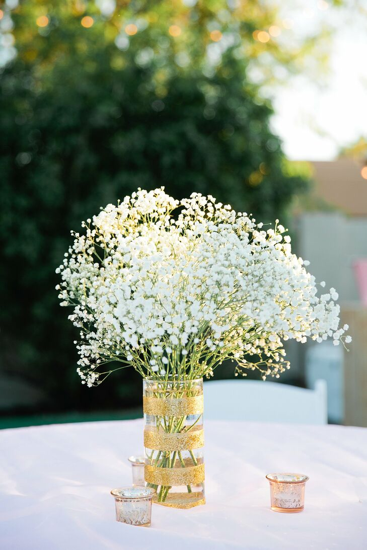Gold sparkly vase with baby s breath centerpiece