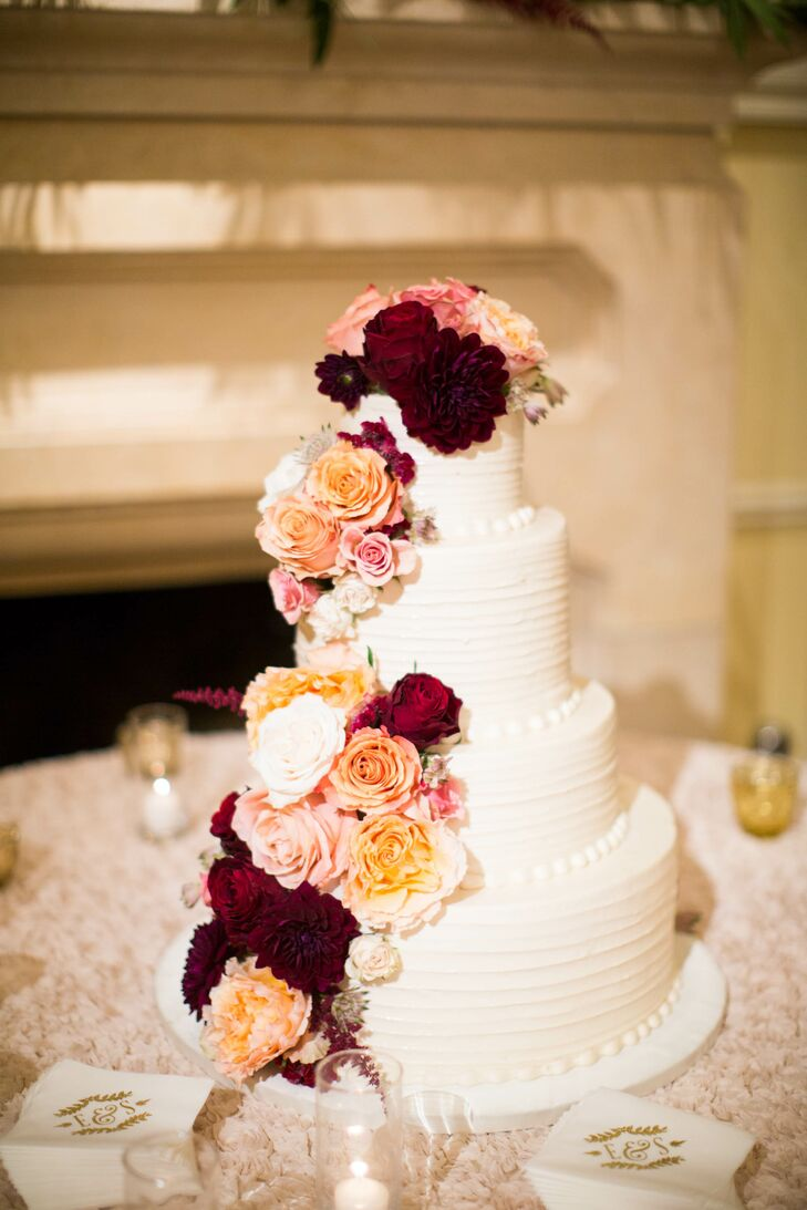 Wedding Cake With Cascading Pink And Burgundy Roses