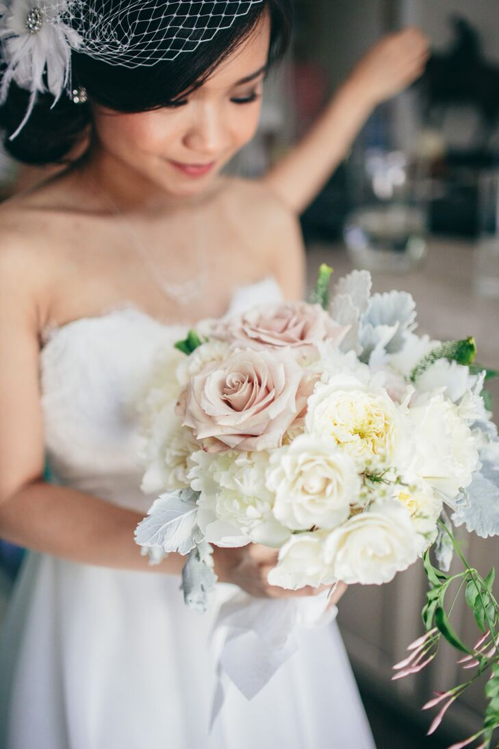 Wild Green Yonder, An and Eddie's florist, designed a natural, romantic bouquet fit for any garden affair. An's arrangement was filled with white peonies, white roses, white garden roses, dusty miller, greenery and mauve roses as green ribbon wrapped around its stems.